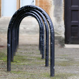 Jowett Walk, Oxford, United Kingdom, February 19, 2017: Empty bl. Ack painted bicycle parking metal frames on the street in Oxford, England Royalty Free Stock Image
