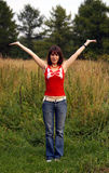 Joy!. Brown-haired young woman showing joy and happyness at the middle of summer meadow Royalty Free Stock Images