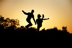 Joy. A couple jumps for joy Royalty Free Stock Photography