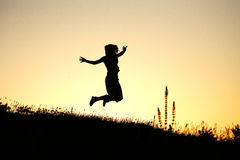 Joy. A girl jumps for joy Stock Photos