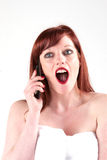 Joy. A woman wrapped in a towel gets some great news Royalty Free Stock Photo