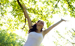 Joy. Young girl spreading hands with joy facing the sun Stock Image