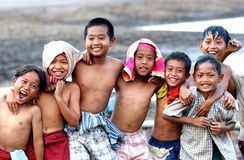 Joy. MADIUN, INDONESIA - August 26th, 2003: Childrens near the storage reservoir Dawuhan, Wonoasri, Madiun, East Java, Indonesia on August 26th, 2003 Royalty Free Stock Photos