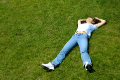 Joy 4. Girl lying on grass relaxing royalty free stock images