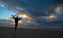 Joy. A person jumping for joy during sunset Royalty Free Stock Photography