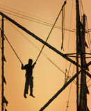 Joy. A silhouette of a boy doing trapeze acts Stock Photo