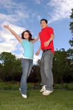 Joy. Exhuberant young couple jump for joy stock photo