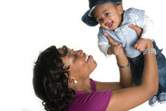 Joy. Mother Holding Baby Boy in the Air Smiling Royalty Free Stock Photos