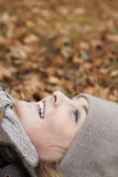 Joy of Autumn - Cute woman lying Royalty Free Stock Photo