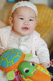 Joy baby with a tortoise toy Stock Image