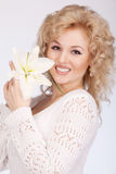 The joy beautiful young woman. With natural flowers Royalty Free Stock Photo