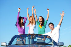 Joy in cabriolet. People group  fun  in cabriolet Stock Images