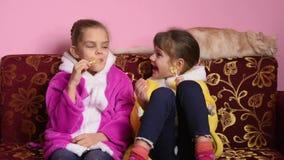 The joy of children who suck lollipops stock video footage