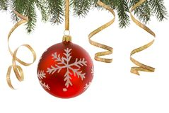 Joy of Christmas. Christmas bauble and golden ribbon on white stock photo