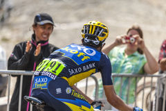 The Joy of Cycling. Mont Ventoux, France- July 14 2013: The Spanish cyclist Alberto Contador (Team Saxo Thinkoff), climbing the last kilometer of the ascension Royalty Free Stock Images