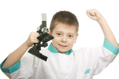 Joy of discovery. Little scientist expressing joy of discovery photo over white Stock Photos