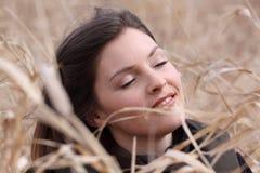 Joy in field. Woman taking break in a field Stock Photo