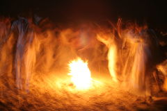 The Joy of Fire. Campfire next to the Nile, Egypt; people dancing and singing in Arabic costume stock photography