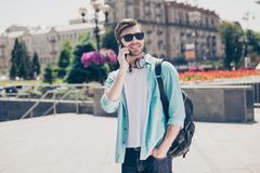 Joy fun bluetooth modern earphones people communication connecti. On concept. Portrait of handsome cheerful excited delightful joyful with stylish hairdo guy Royalty Free Stock Image