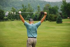 The Joy of Golf. A golfer shows his frustration or he could be just working out some tight muscles Stock Photos