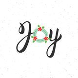 Joy hand written modern brush lettering inscription. Lettering Noel text with Christmas wreath. Holiday design, art print for post Stock Photo