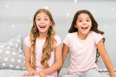 Joy and happiness. Happy together. Kids girls sisters best friends full of energy in cheerful mood. Good morning concept. Children cheerful play bedroom. Great stock photos