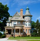 Joy House. This is a Summer picture of the C.R. Joy House located in Keokuk, Iowa.  The house was designed by George Franklin Barber, is an example of Queen Anne Royalty Free Stock Photo