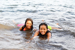 Joy Inside The Water. Two beautiful Asian girls enjoying the swim with a smile royalty free stock photography