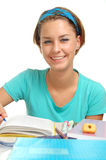 Joy of learning. A smiling female student learning royalty free stock photography