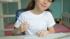 Joy learning homework. Cheerful girl studying exercises. pupil sing good mood stock video
