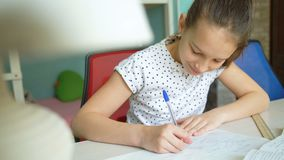 Joy learning homework. Successful implementation homework. pleased pupil studying mathematics lessons stock footage