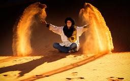 Joy of life. Berber throwing with sands in Desert Sahara, Morocco