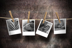 The joy of motherhood. Four pictures on motherhood and newborn attached to a rope with clothes spins on a grunge background Stock Images