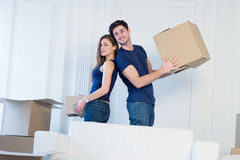 The joy of moving into the house. A loving couple holding box in Royalty Free Stock Photos
