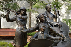 The Joy of Music - Holland, Michigan. This collection of five statues includes three musicians and two singing children in the Alpenrose Park . Artist: George Stock Photo