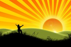 The Joy of the new day. Man rejoices new day on glade Royalty Free Stock Image
