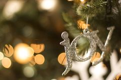 Joy ornament on christmas tree. Joy ornament hanging on a Christmas tree Royalty Free Stock Photos