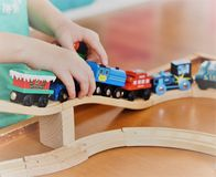 Joy of playing with wooden trains royalty free stock photography