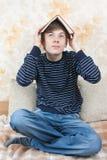 Joy reading school boy. Young joy boy readig book on sofa at home Stock Photo