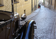 Joy ride on the retro car. Retro car in the old town Stock Photography