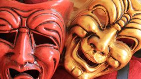 Joy and sadness Carnival mask. Red and gold carnival  plaster mask in close-up Royalty Free Stock Photo