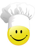 Joy of smiley face cooking in happy chef hat Stock Photo