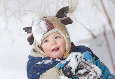 Joy on snow. Baby playing in the snow Royalty Free Stock Photo