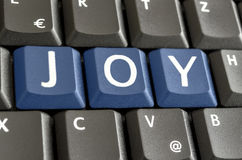Joy spelled on computer keyboard Stock Photo