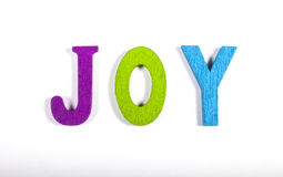 JOY. Spelt out in bright coloured letters over a white background Royalty Free Stock Photos
