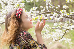 The joy of spring. Happy girl near the blossoming apple tree Royalty Free Stock Photography