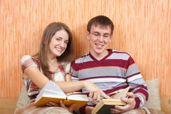Joy students with books at home Royalty Free Stock Photography