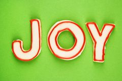 Joy sugar cookies. Sugar cookies with decorative icing that spell joy Royalty Free Stock Photos