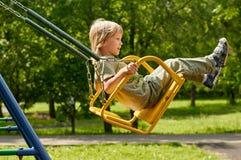 Joy swing. boy Royalty Free Stock Photo