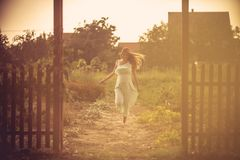 Joy to a new life. Pregnant woman running to home. Copy space royalty free stock images